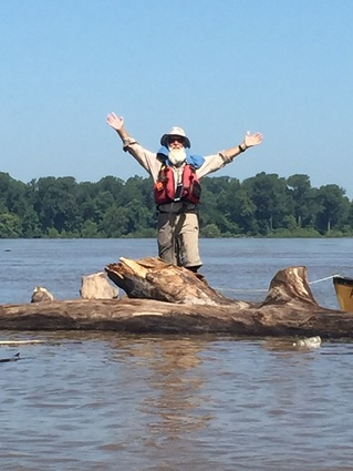 Dale Sanders on a floating log